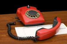 Free Red Phone On A Wooden Table Royalty Free Stock Photo - 18080885