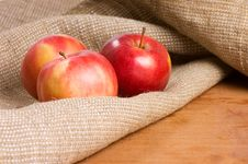 Free Apples On A Sacking On A Wooden Table Stock Image - 18081101