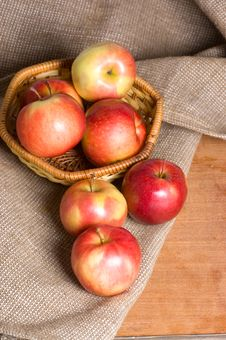 Free Apples On A Sacking On A Wooden Table Royalty Free Stock Photos - 18081108