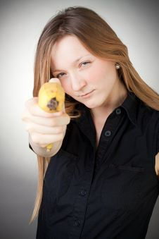 Free Image Of Girl Holds Banana As A Gun Royalty Free Stock Photos - 18082898