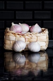 Garlic Bulbs In Basket Stock Photography