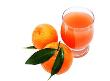 Free Glass Of Juice And Two Mandarins Stock Photography - 18084372