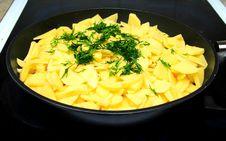 Sliced Raw Potatoes On Frying Pan Stock Photography