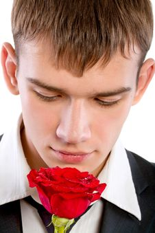 Free Man Smelling A Rose Stock Photography - 18085822