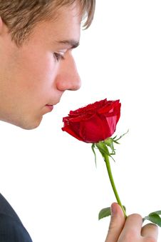 Free Man Smelling A Rose Stock Photo - 18086300