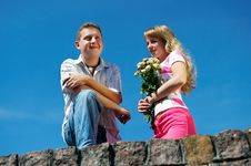 Free Young Woman With Flowers And Her Boyfriend Stock Images - 18086604