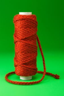 Bobbin Of Red Thread Royalty Free Stock Image