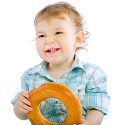 Free Little Baby Boy Holding A Bagel Royalty Free Stock Photos - 18088418