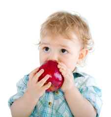 Free Beautiful Baby Boy Eats Red Apple. Royalty Free Stock Image - 18088666