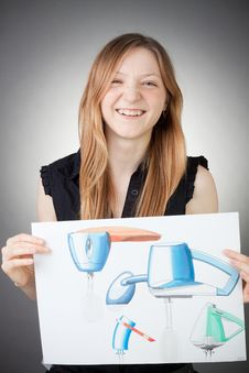 Free Young Design Engineer Woman Shows A Design Plan Royalty Free Stock Photo - 18088825