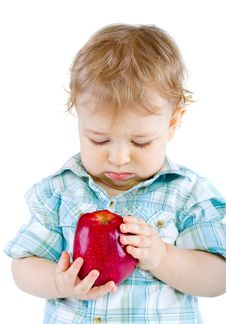 Free Beautiful Baby Boy Eats Red Apple. Stock Image - 18088831