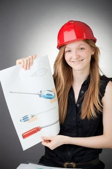 Free Young Design Engineer Woman Shows A Design Plan Royalty Free Stock Photos - 18088878