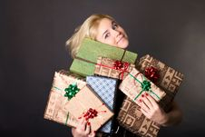 Free A Lovely Woman Holding A Many Gift Boxes Stock Photography - 18089032