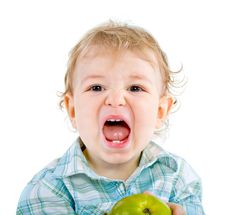 Free Beautiful Baby Boy Eats Green Apple. Stock Photos - 18089043
