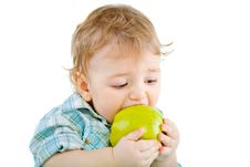 Free Beautiful Baby Boy Eats Green Apple. Stock Images - 18089164