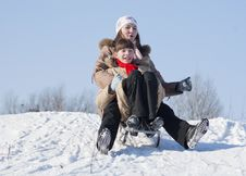 Free Two Happy Sisters Sledding Royalty Free Stock Images - 18089179