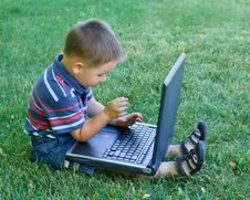 Free Boy And Laptop Royalty Free Stock Photo - 18089245