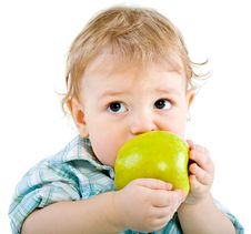 Free Beautiful Baby Boy Eats Green Apple. Royalty Free Stock Photography - 18089297