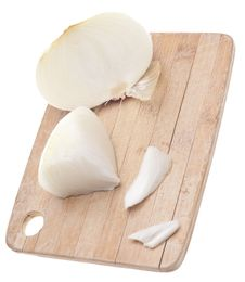 Free Sliced White Onions On A Wooden Chopping Block Stock Photos - 18089663