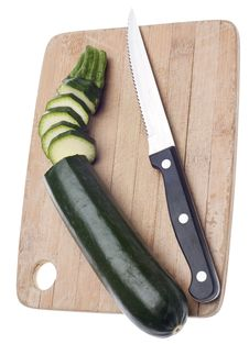 Free Sliced Zucchini On A Wooden Chopping Block Royalty Free Stock Images - 18089709