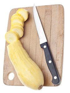 Free Sliced Yellow Squash On A Wooden Chopping Block Royalty Free Stock Photography - 18089737