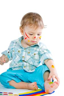 Free Beautiful Baby Covered In Bright Paint Royalty Free Stock Photography - 18089867
