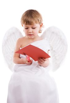 Boy Angel Cuts Heart Stock Photos