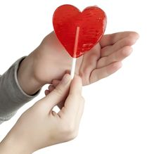 Free Candy Red Heart In The Hands Royalty Free Stock Photography - 18092037
