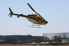 Free Yellow Helicopter In A Low Fly Over Royalty Free Stock Photography - 18093717