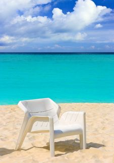 Free Chair On Tropical Beach Royalty Free Stock Image - 18095376