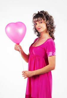 Free Young Beautiful Girl Holding A Balloon Heart Stock Photos - 18095743