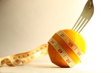 Free Orange With Measurement Tape And Fork Stock Photos - 18096263