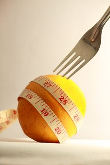 Free Orange With Measurement Tape And Fork Royalty Free Stock Image - 18096296