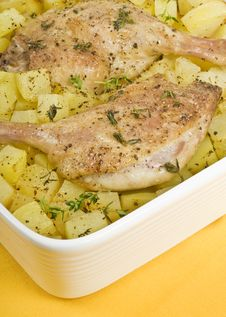 Roasted Duck Legs And Potatoes Stock Images