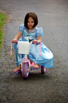 Free Cinderella On A Bike Royalty Free Stock Photo - 1815715