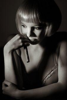 Girl Smoking Cigar Stock Images