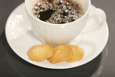 Dark Coffee And Cookies Stock Images