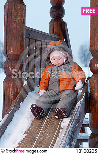 Free Cute Baby Prepare To Slide Down The Slides Royalty Free Stock Photo - 18100205