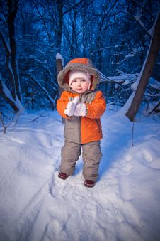 Baby Walking In Park. Putting On Mittens Royalty Free Stock Photography