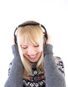 Free Pretty Blond Listening To Music Royalty Free Stock Image - 18100146