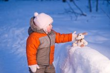 Free Cute Baby Touch Toy Dog On Snow Royalty Free Stock Photos - 18100728