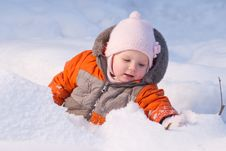 Cute Baby Sit In Snow In Forest And Dig Snow Stock Photos
