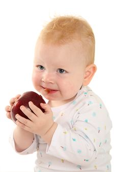 Free Portrait Of A Beautiful Child With A Red Apple Royalty Free Stock Image - 18101676