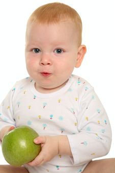 Free Beautiful Baby With A Green Apple. Stock Images - 18101754