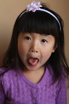 Asian Girl With Tongue Out Stock Photo