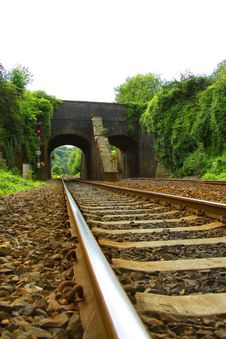 Free Railway Line Leading Under Viaduct Royalty Free Stock Photos - 18104938