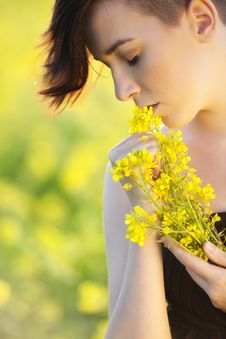 Girl With Flowers. Stock Photos