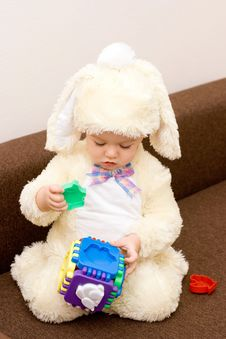 Pretty Caucasian Baby In Rabbit Costume Playing Royalty Free Stock Photos