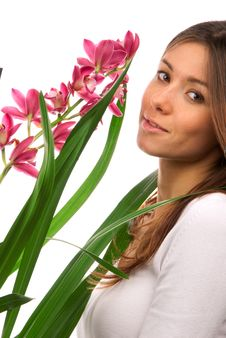 Free Brunette Woman Smelling Purple Orchid Flower Royalty Free Stock Image - 18109926