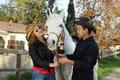 Free Couple Petting Horse Stock Photo - 18112290